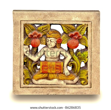 The Relief carving of women isolated on white background. This is traditional and generic style in Thailand. No any trademark or restrict matter in this photo.