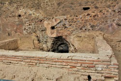 The remains of a communal bath within the ruins of the ancient Roman city of Pompeii, Italy, that was destroyed by Mount Vesuvius erupting in 79AD