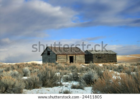 The remains of an old barn on a prairie in Montana