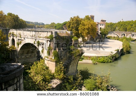 The remains of the ancient Ponte Rotto, with Isola Tiberina (Tevere Island) in the background, Roma, Italy