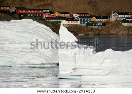 The remains of two icebergs floating near the city of Amassalik, Greenland