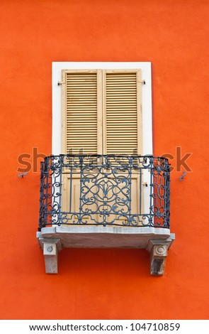 The Renovated Facade of the Old Italian House with Balcony