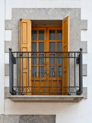 The Renovated Facade of the Old Spanish House with Balcony