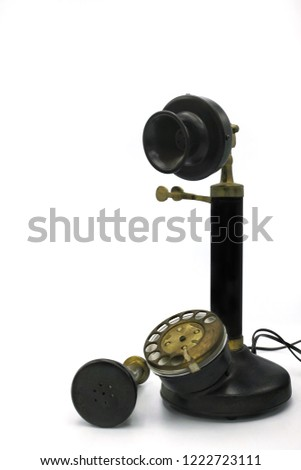 The replica of candlestick telephone. Candlestick telephone is a vintage telephone that was used very long time ago also calls as a desk stand phone, an upright, or a stick phone. #1222723111