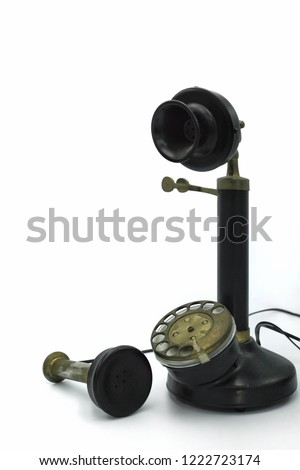 The replica of candlestick telephone. Candlestick telephone is a vintage telephone that was used very long time ago also calls as a desk stand phone, an upright, or a stick phone. #1222723174