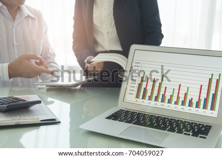 The report summarizes the result of business operation on computer screen and business people meeting.