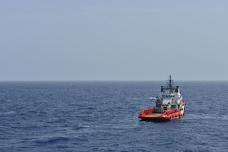 The rescue and supply boat for offshore oil rig operation.