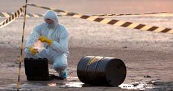 The researcher puts a contaminated soil sample in a laboratory case.
