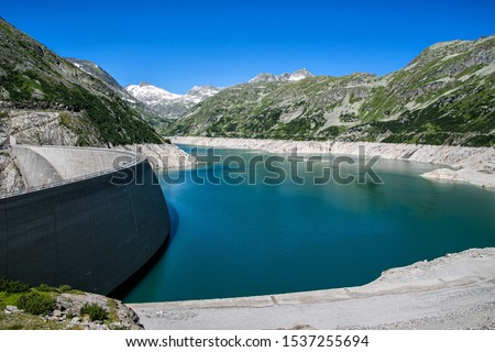 The reservoir behind the Kölnbrein dam in the upper Maltatal valley of the river Malta in the High Tauern mountain range, Carinthia, Austria. Stock photo ©