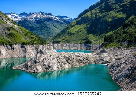 The reservoir lake of the Kölnbrein dam in the upper Maltatal valley of the river Malta, High Tauern mountain range, Carinthia, Austria. Stock photo ©