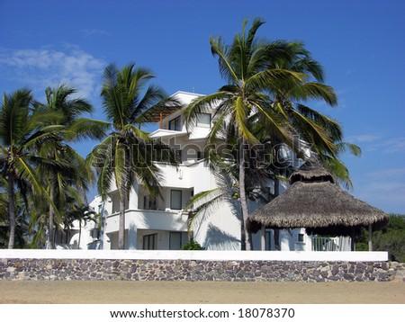 The resort building on a beach in Manzanillo city, Mexico.