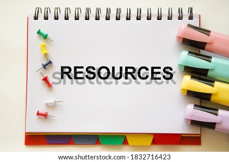 the resources text is written on a white notepad. Enterprise resource planning concept. Business structure and many business icons. High quality photo Foto stock ©
