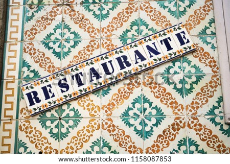 The restaurant title on the wall decorated of ceramic titles #1158087853