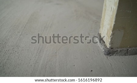 The result is finished flooring work with mortar. The status of the results of the process of interior decoration of the floors of the premises. Floor repair