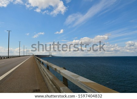 The Öresund bridge bridge tunnel through the Öresund strait against the backdrop of a beautiful cloudy sky. View of the border of Denmark and Sweden from Sweden.