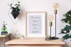 The retro mock up photo frame on the vintage wooden shelf , hanging plant in design pot, green sprinkler gold pyramid, plants and accessories. Concept of minimalistic shelfie. Home decor. Template.