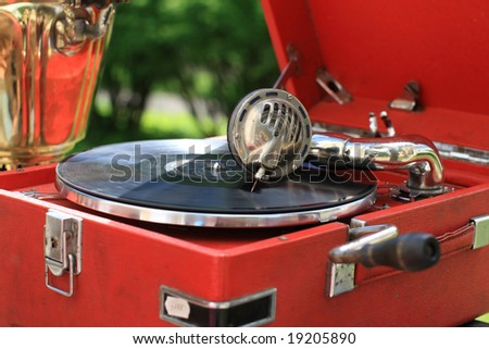 The retro portable gramophone with disc, outdoor
