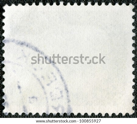 The reverse side of a postage stamp on a black background
