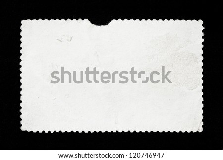 The reverse side texture of used post stamp on black background