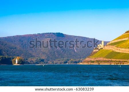 The Rhine near Bingen, Germany. Part of the UNESCO World Heritage Site- Upper Middle Rhine Valley. On the left the Mouse Tower (Maeuseturm), on the right the castle Burg Ehrenfels.