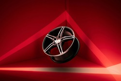 the rim is a modern sports alloy wheels, on a bright red background.