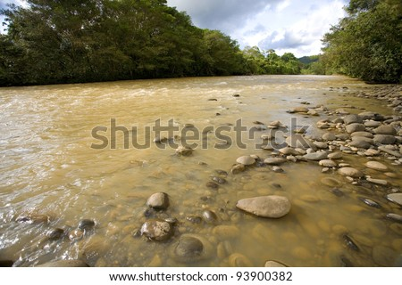 The Rio Coca in the Ecuadorian Amazon. The water brown with sediment because of deforestation upstream