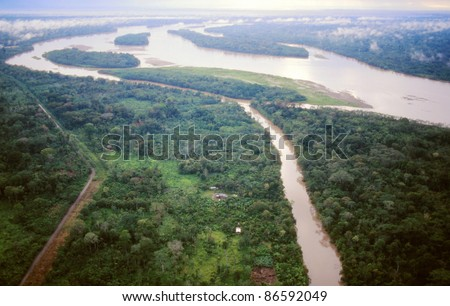 The Rio Napo in the Ecuadorian Amazon viewed from the air, Rio Jivino in foreground and a road built by oil companies bringing colonists who cut the foreground forest