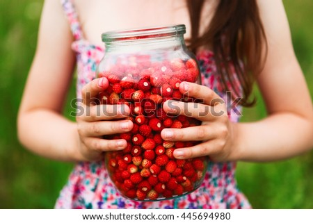 The Ripe strawberries in a glass container.