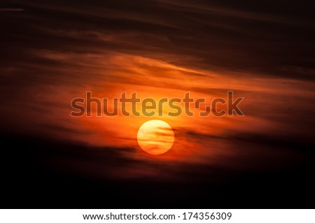 The rising sun has painted the sky in orange colour