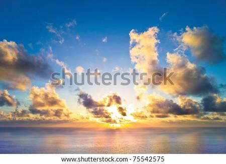 The rising sun over the sea   #75542575