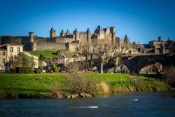 The River Aude and Old Bridge (Pont Vieux, 14th Cent) leading to Medieval town of Carcassonne (Cité), Languedoc-Roussillon, France.