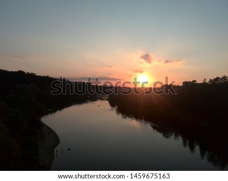 the river between sunset and sunset