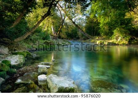 The river Ceou< Dordogne, France.