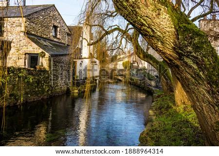 The River Eea flows through the pictuesque village of Cartmel, Cumbria. Stock photo ©