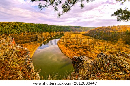 The river in the autumn valley. Autumn river landscape. Autumn river valley panorama