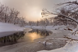 The river in the winter at sunset in Russia on the peninsula of Kamchatka