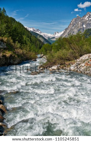 the river in Val Ferret during the melting of snow in spring, Aosta Valley - Italy #1105245851