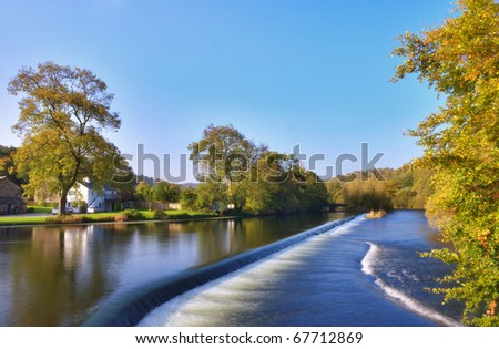 The River Leven and weir at Newby Bridge, Cumbria, England