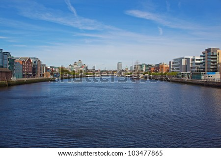The River Liffey in Dublin, Ireland with a view of the Custom House and Liberty Hall