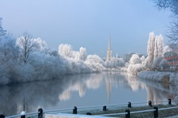 The river Severn at Worcester on a very frosty morning with St Andrew's church. England.