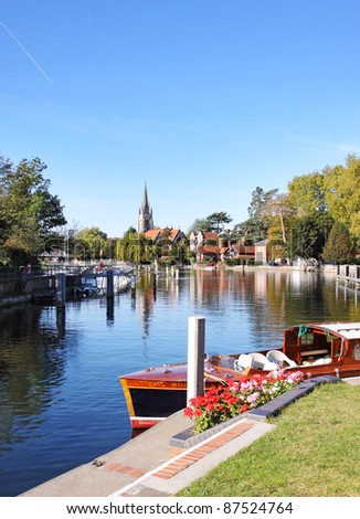 The River Thames at Marlow in England with Weir and Church in the background