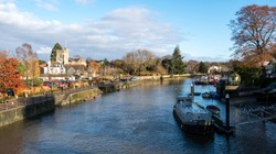 The River Thames between Twickenham and Richmond, west London UK. Photographed from the pedestrian bridge to Eel Pie Island on a clear winter's day in December.