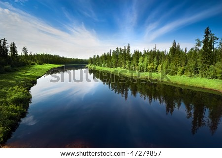 The river with a quiet current and clouds reflected in it, Sakha (Yakutia) Republic, Eastern Siberia, Russia