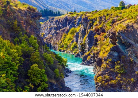 The river with bright green water. Incredible Adventures in New Zealand. Picturesque gorge and river Kawarau between Cromwell and Queenstown. The concept of extreme, active and photo tourism
