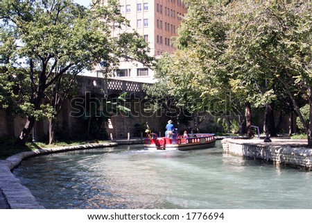 The Riverwalk in San Antonio, Texas on a sunny day.  This attraction is in the heart of downtown San Antonio.