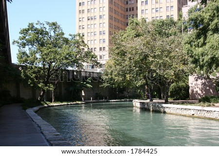 The Riverwalk in San Antonio, Texas on a sunny day.  This attraction is in the heart of downtown San Antonio. - stock photo