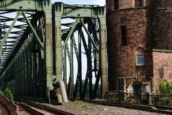The riveted steel beams and a part of a bridge pylon of a railway bridge, the south bridge in Mainz / Mainz South Bridge