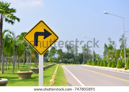 The road ahead turn right, Road symbol signs and traffic symbols for roadway, Yellow board with reflection and concrete post
