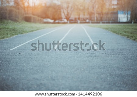 The road from asphalt with lines. The concept of choosing a path in business. All ways are free and without competition. Ahead of sunlight as success ahead of the way. #1414492106
