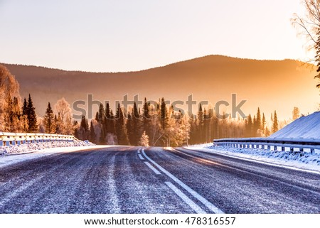 The road in the winter mountains in the background   #478316557